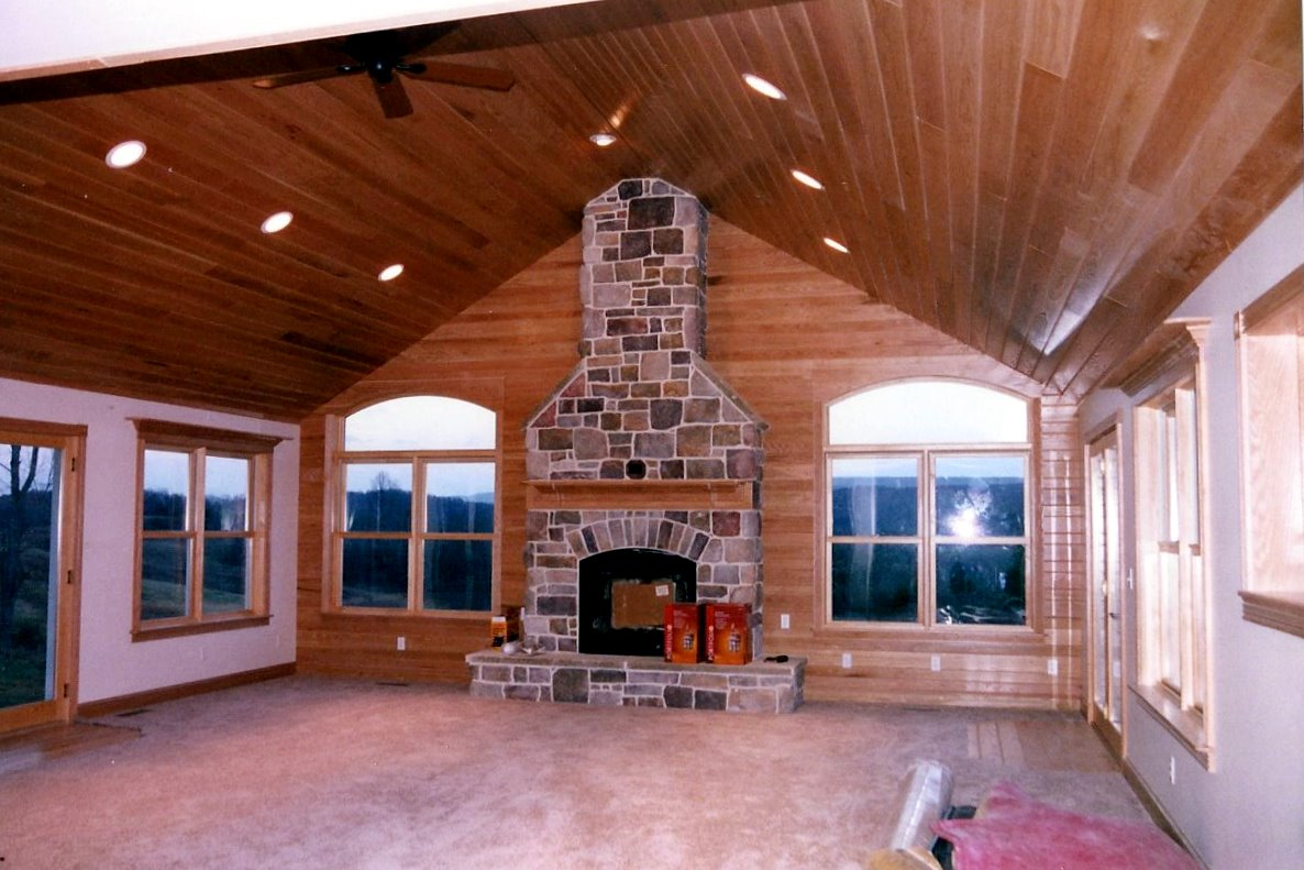 Addition to an existing home interior with fireplace